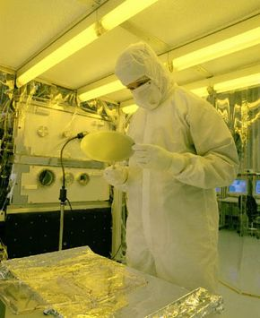 An engineer inspects a wafer freshly printed from the prototype machine using EUVL.