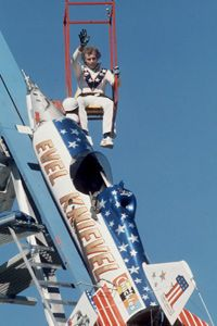 Evel Knievel waves as he's lowered to his rocket prior to his failed attempt at a highly promoted leap across Snake River Canyon in Twin Falls, Idaho, on Sept. 8, 1974.
