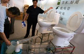 In Beijing, China a very low-flow toilet is demonstrated using only a half-gallon of water.