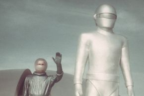 """Klaatu (left) and Gort (right) emerge from their spacecraft in a promotional still from the 1951 film """"The Day The Earth Stood Still."""""""