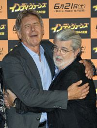 """""""Indiana Jones"""" executive producer George Lucas, right, poses with star Harrison Ford at a recent premiere."""