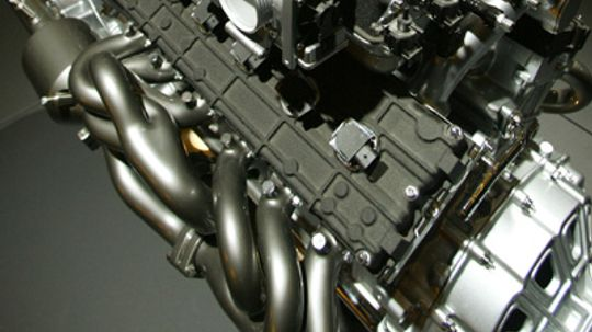 How do exhaust headers work to improve engine performance?