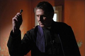 """""""Father Moore"""" dressed in surplice and purple stole in """"The Exorcism of Emily Rose"""""""