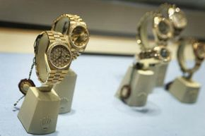 Jewel-encrusted luxury watches are displayed in a window at a store in Dubai.