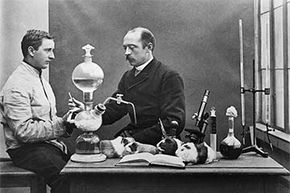 German physiologist Emil von Behring, who won the 1901 Nobel Prize for his work with tetanus and diphtheria immunizations, is shown in his lab with an assistant and some anxious-looking guinea pigs.