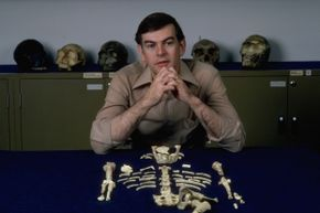 """Paleoanthropologist Donald Johanson and his find, """"Lucy,"""" the first nearly complete Australopithicus afarensis discovered."""