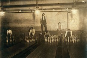 These pin boys were photographed at 1 a.m. in 1910, setting up pins in a Brooklyn bowling alley for $2 or $3 a week.