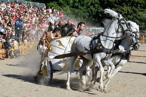 The Arde Lucus festival in Lugo, Spain celebrates the  Gallaecian-Roman heritage of the city. Here people participate in a recreation of a chariot race.