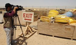 TV Show Image Gallery A Iraqi cameraman films decontaminated barrels at a waste facility in Tikrit, Iraq in July 2010. See more TV show pictures.