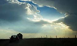 A group of storm chasers follow an ominous set of clouds.
