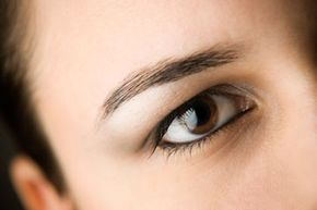 Apply a neutral shade under the brow and an accent shade in the crease of your eye.