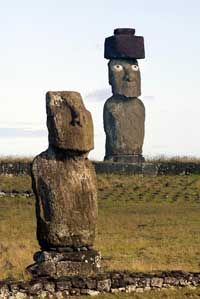 The moai are Easter Island's most recognizable feature. The moai on the right has been restored after having been torn down and its eyes gouged out.