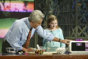 """There have been numerous Easy-Bake oven baking contests throughout the years. Here, the 2003 winner, Olia Wall, appears on """"The Tonight Show with Jay Leno"""" to share her culinary tips."""