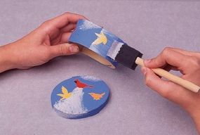 Spread some decoupage finish over the fly away decoupage box by using a sponge brush.