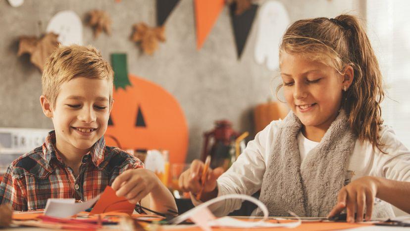 Kids doing Halloween crafts