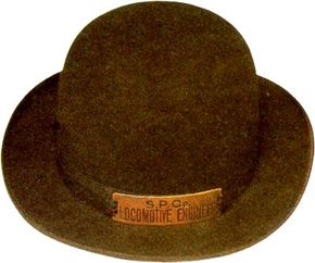 Although the traditional striped cap has become synonymous with railroad engineers, other styles of headgear were not uncommon. This version, bearing a Southern Pacific hat plate, has been dated to sometime before 1920.