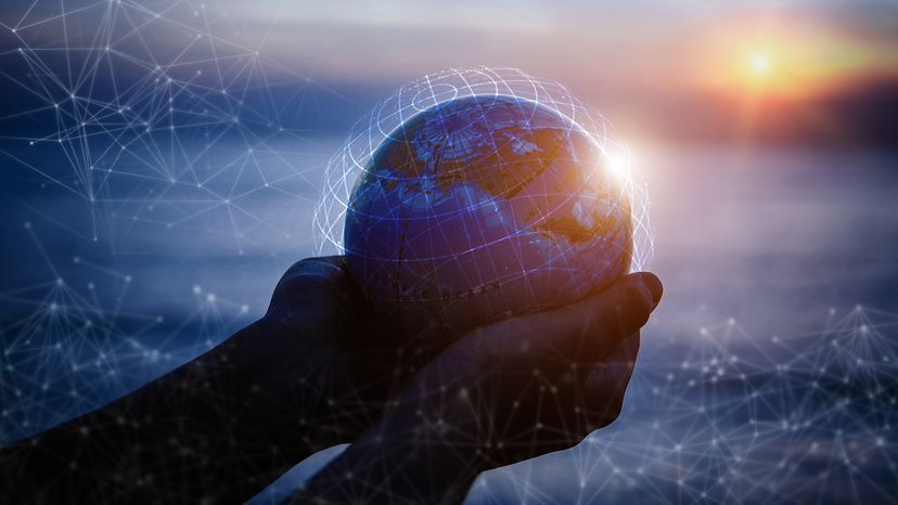 small hands holding a globe