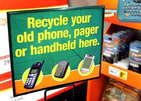 A sign displays recyclable items at an 'e-waste' drop-off location inside a Staples store.
