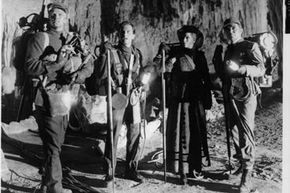 """The cast of the 1959 movie """"Journey To The Center Of The Earth,"""" looks up inside a cavern.  What will scientists find when they make the real journey?"""