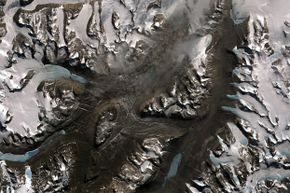 Scientists like the Dry Valleys because the lack of ice makes it easier for them to study the geological processes affecting Antarctica.