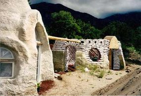 This earthbag home connects several small domes