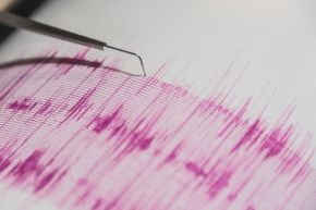 A seismometer is hard at work detecting what's shaking with the ground.