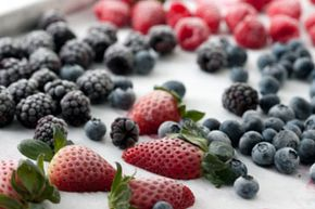 Freeze fresh fruit flat on a cookie sheet. Once solid, transfer the food to plastic bags for easy storage.