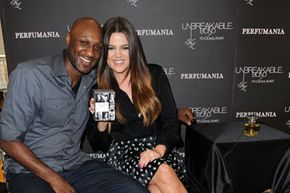 "Two members of the ubiquitous Kardashian Klan, Khloe and Lamar Odom, pose with their eau de toilette fragrance ""Unbreakable Bond."""