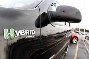 Image Gallery: Hybrid Cars The hybrid logo shines off the front fender of an unsold 2008 Yukon hybrid sports-utility vehicle priced at more than $56,000 on the lot of a GMC Truck dealership in the south Denver suburb of Littleton, Colo., on Feb. 17, 2008. See more pictures of hybrid cars.