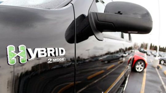 What is the economic impact of hybrid cars?