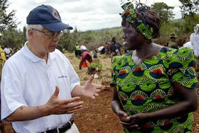 Dr. Wangari Muta Maathai, a noted Kenyan ecofeminist and the 2004 Nobel laureate, speaks with Mitsubishi's senior executive vice president at a joint tree planting ceremony in Nairobi's Karura Forest.