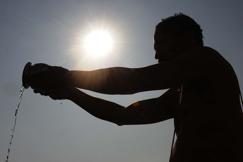 solar eclipse, india, water ceremony