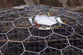 Each ETFE pillow is secured in the steel framework.