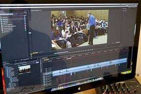 An edX video editor works on a video of an MIT biology class. EdX classes are a combination of videos, quizzes, discussions and short essays -- all online.