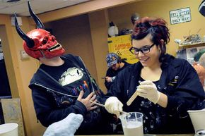 Instructor Shawn Ronzio of Tom Savini's Special Effects Program in Pittsburgh shares a laugh with student Alana Schiro at a sculpture class in 2010. Savini has run this program, which teaches movie make-up effects, since 2000.