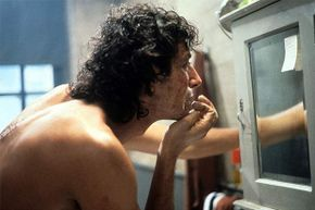 Jeff Goldblum checks out his bumpy skin in a scene from the film 'The Fly.'