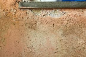 Efflorescence deposits are usually white, like the ones shown here, but they also can be yellow or green. See more home construction pictures.