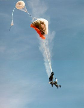 The parachutes opening on a Martin-Baker ejection seat during a test. The small parachute at the top is called the drogue parachute.