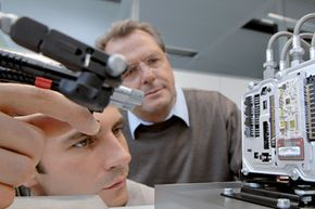 A precision laser is used at the Bosch engineering center in Abstatt, Germany, to measure the intrinsic vibration of a brake control unit.