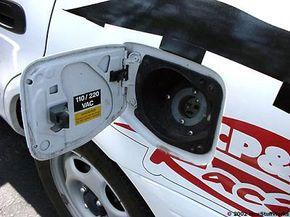 Opening the gas filler door reveals the charging plug.