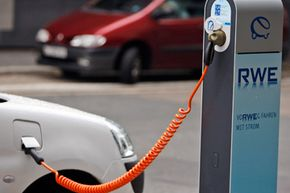 Image Gallery: Electric Cars A charging point for electric cars is seen at the headquarters of energy supplier RWE in Essen, western Germany. See more pictures of electric cars.