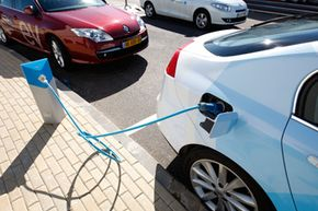 An electric car is connected into power supply at a recharge station during a demonstration of the California-based company Better Place in Tel Aviv, Israel, on Feb. 7, 2010.