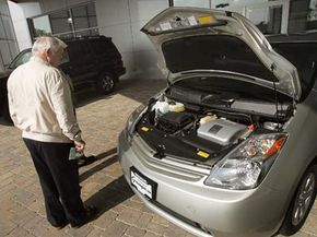 Although makers of available conversion kits claim to make cars like the Prius pictured above more efficient, there may be additional risks and challenges that come with them.