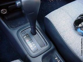 An automatic transmission shifter is used to select forward and reverse. It contains a small switch, which sends a signal to the controller.