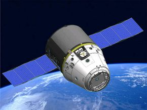 Dragon spacecraft (capsule and trunk) with solar panels deployed