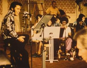 Elvis Presley is relaxed in a rehearsal that was filmed for the documentary Elvis -- That's the Way It Is.