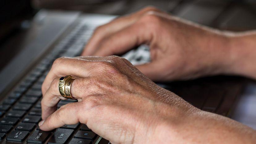 older woman typing