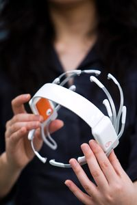 The Emotiv EPOC headset usesseven pairs of electrodes that read your thoughts and play the video game.