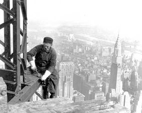 A structural worker on a steel girder during the construction of the Empire State Building in 1930