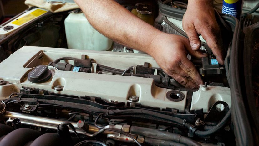 Man Working on Engine Auto Parts